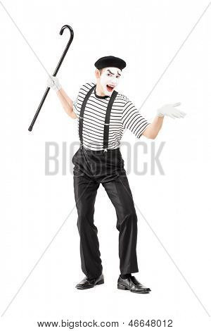 Full length portrait of a mime artist holding a cane and gesturing isolated on white background
