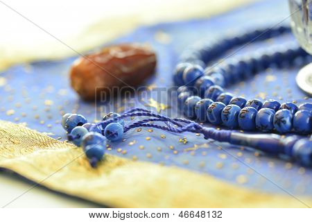 Single date and rosary close up