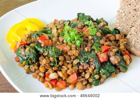 Stewed lentils with spinach, pepper and onion