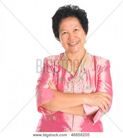 Asian senior woman. Happy smiling Asian grandparent standing isolated on white background.