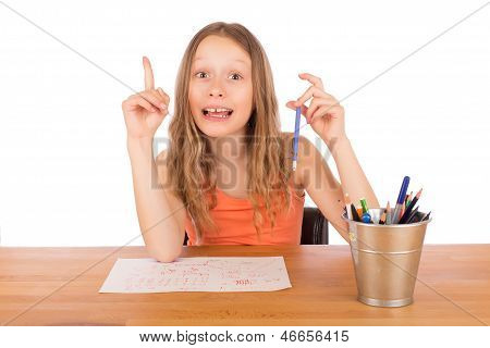 Child Sitting At A Table Found An Idea To Draw