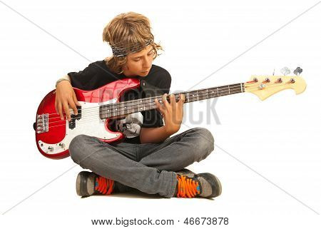 Teen Boy Playing Bass Quitar