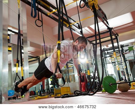 fitness TRX push ups man workout at gym