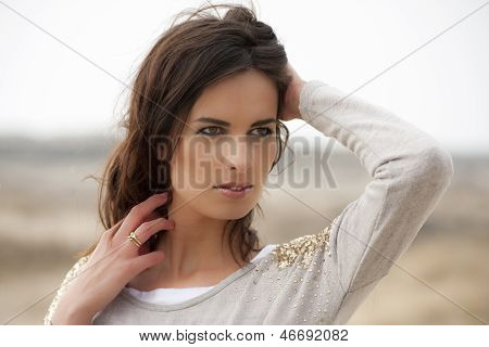 Portrait Of A Beautiful Brunette With Brown Eyes