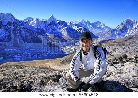 Hiker in front of the Khumbu Valley with the Himalayan Mountain Range and the outstanding Ama Dablam Mountain in the Sagarmatha (Mount Everest) National Park in Nepal