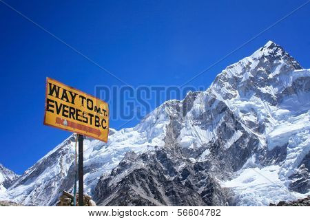 Signpost to the Mount Everest Base Camp with Nuptse mountain in the background, Nepal