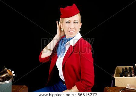 Retro Airline Stewardess Preparing For Work