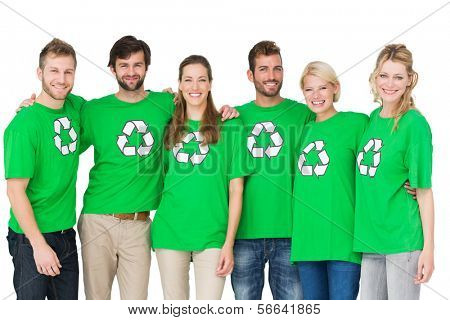Group portrait of young people wearing recycling symbol t-shirts over white background