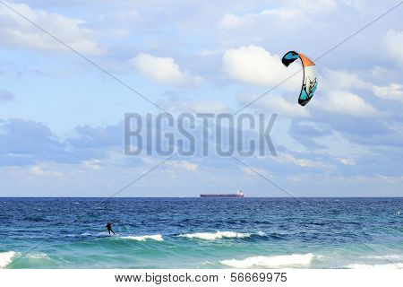 Kiteboarder And Tanker Cargo Boat