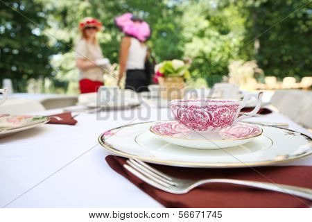 Tea cup and place setting at a tea party