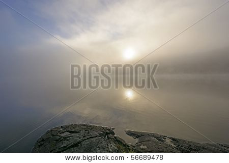 Sun And Fog On A Wilderness Lake