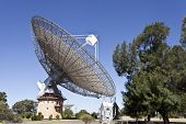The historical radio telescope dish which actively took part in the 1969 first landing of man in the moon located in Parkes, New South Wales, Australia. poster