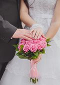 Hands and rings it is beautiful wedding bouquet poster