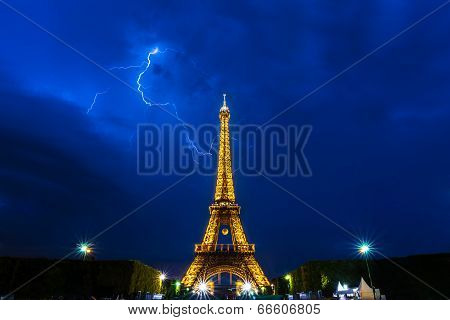 Thunderstorms behind Eiffel Tower at night