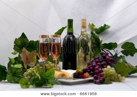 Wine And Grapes with fruit and cheese