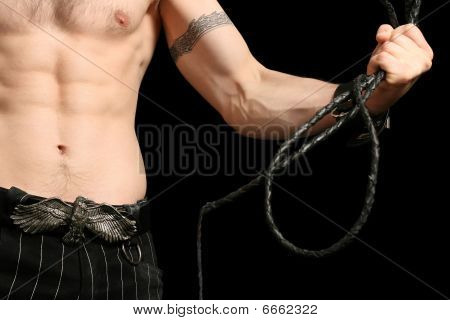 Strong male holding a whip