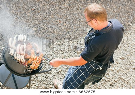 Man at the barbecue grill