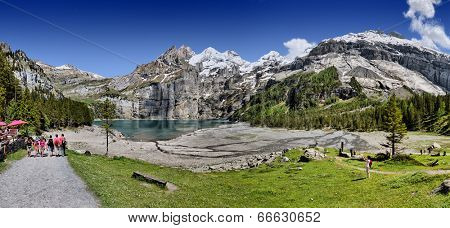 OESCHINEN LAKE, KANDERSTEG, SWITZERLAND - JUNE 8, 2014 - Since 2007 the Oeschinen lake is part of the Jungfrau-Aletsch-Bietschhorn UNESCO World Heritage Site.