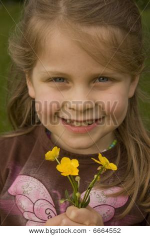Beautiful Blonde Girl with Handfull of Buttercups
