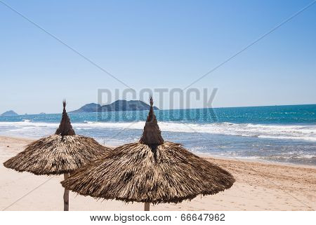 Two Palapas On Empty Mexican Beach