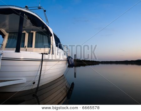 Boat At The Sunset