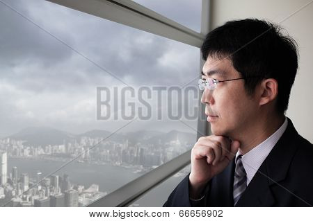 Business Man Look City Through Window