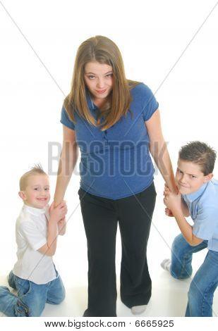 Children Pulling On Mother