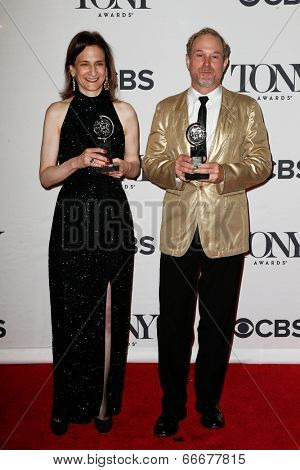 NEW YORK-JUNE 8: Lighting designers Natasha Katz (L) and Kevin Adams pose at American Theatre Wing's 68th Annual Tony Awards at Radio City Music Hall on June 8, 2014 in New York City.