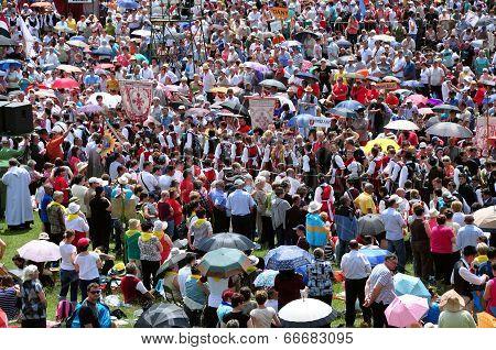 Crowd Of Religious Pilgrims People During A Catholic Celebration
