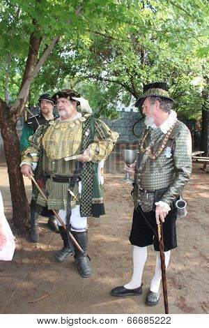 MUSKOGEE, OK - MAY 24: A man dressed as a royal prince stops to talk during the Oklahoma 19th annual Renaissance Festival on May 24, 2014 at the Castle of Muskogee in Muskogee, OK.