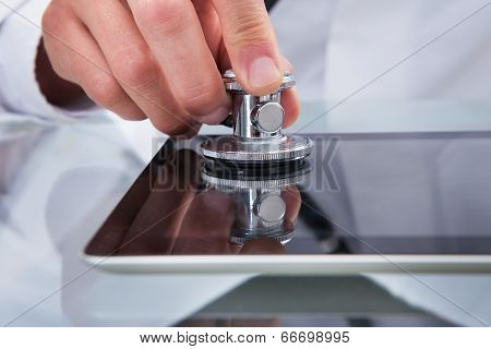 Doctor Analysing The Health Of Tablet Computer