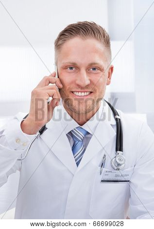 Friendly Doctor Chatting On His Mobile Phone