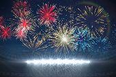 Digitally generated fireworks exploding over football stadium poster