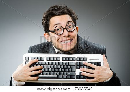 Computer geek with computer keyboard
