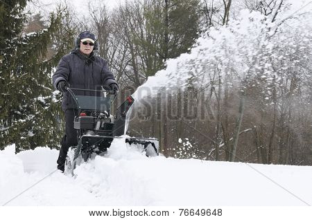 Man Clearing Snow with Snowblower