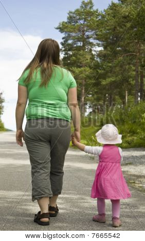 Obese mother and child walking