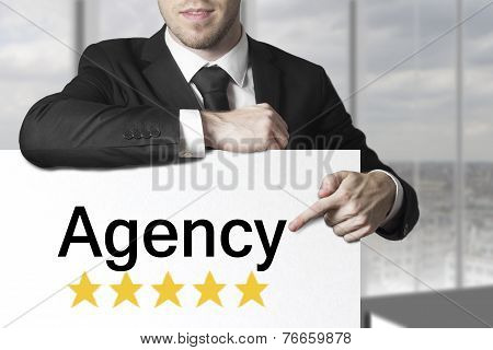 Businessman Pointing On Sign Agency