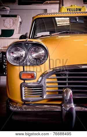Old retro yellow taxi parking in the garage