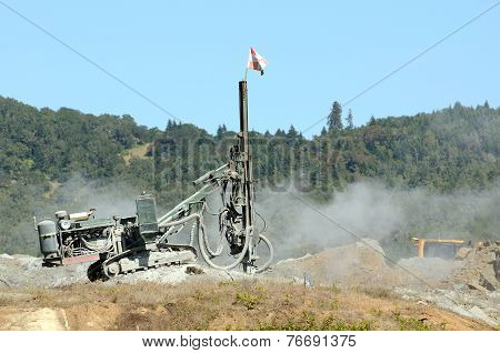 Rock Drill Working A Site In Preparation For A Blasting Operation In Shale Rock