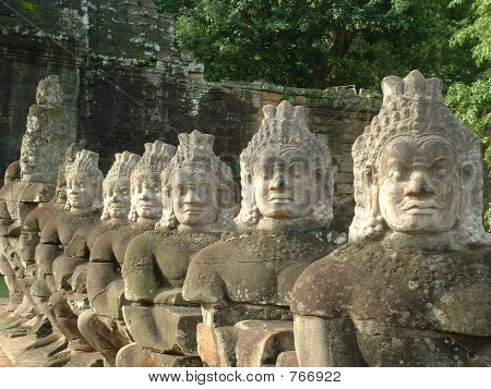 Row of Statues Guarding a Gate at Angkor in Siem Reap, Cambodia