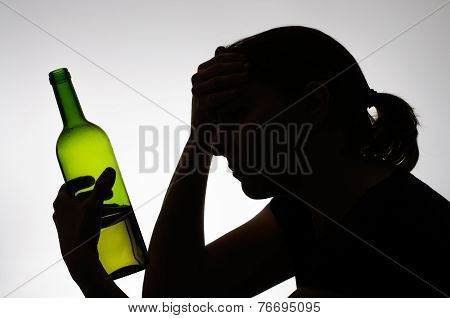 Silhouette Of A Woman Holding A Bottle
