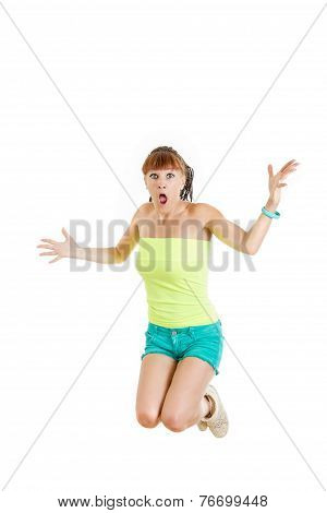 Shocked And Surprised Beautiful Cute Young Woman Or Girl In Blank Green T-shirt And Shorts Jumps