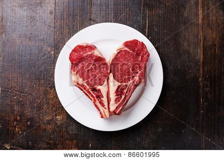 Heart Shape Raw Meat Ribeye Steak Entrecote On White Plate