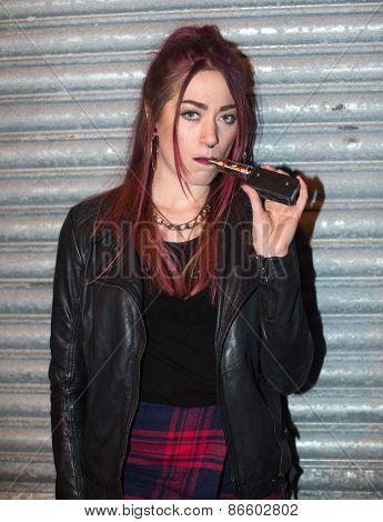 Pretty Trendy Casual Woman Holding An E-cigarette