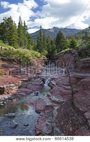 Mountain Stream Flowing Through Red Rock Canyon - Waterton Lakes National Park