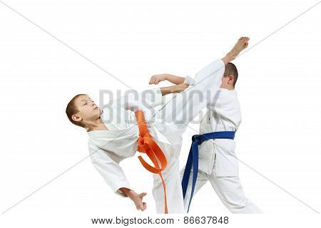 Paired exercises karate are training sportsmens in karategi