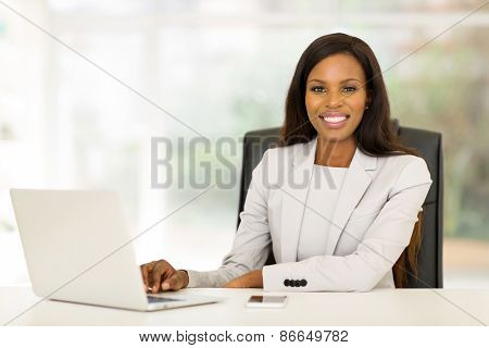 smiling african american business woman using laptop computer