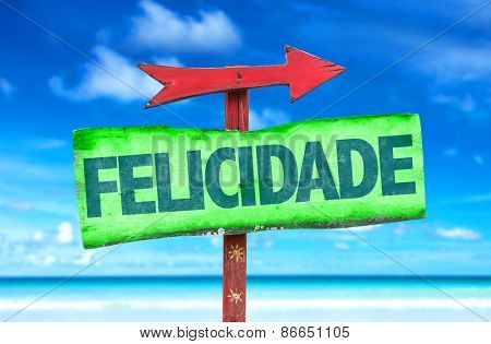 Happiness (in Portuguese) sign with beach background