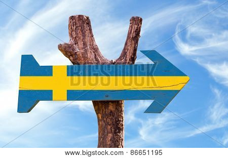 Sweden wooden sign with sky background