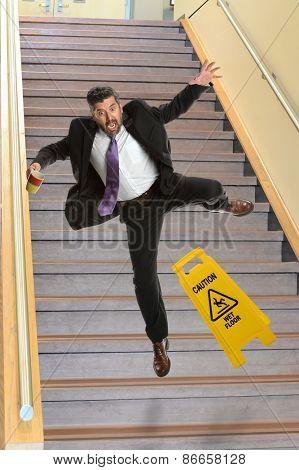 Mature Hispanic businessman falling on stairs
